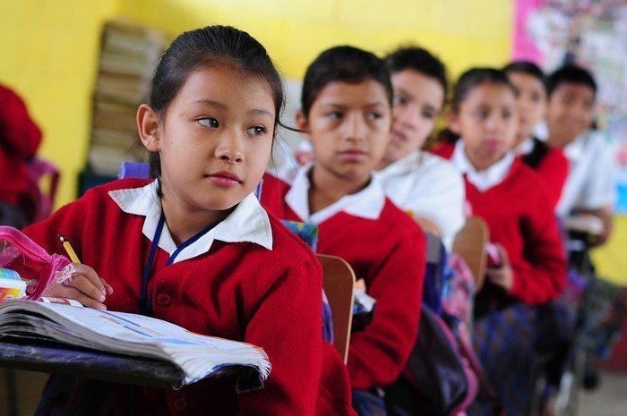 Guatemalan school children in uniform attending class.