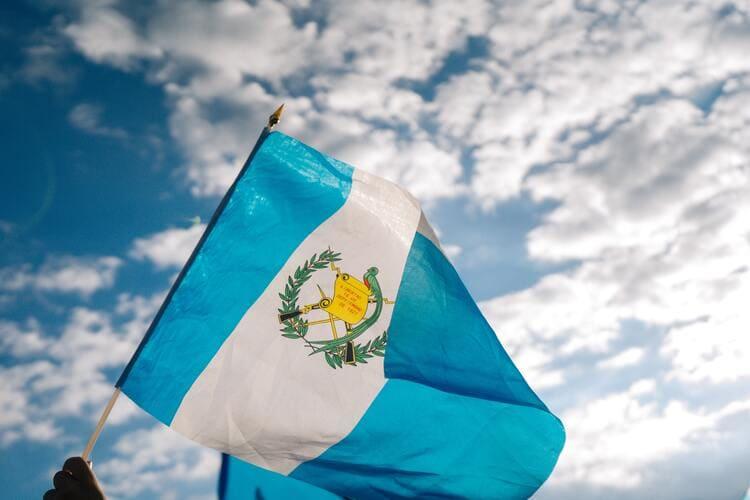 Guatemalan flag against blue sky