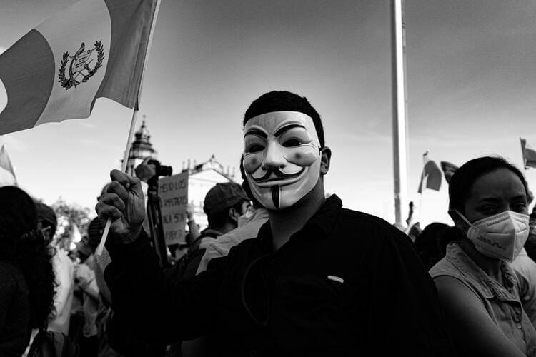 Guatemalan protestor in Guy Fawkes Mask