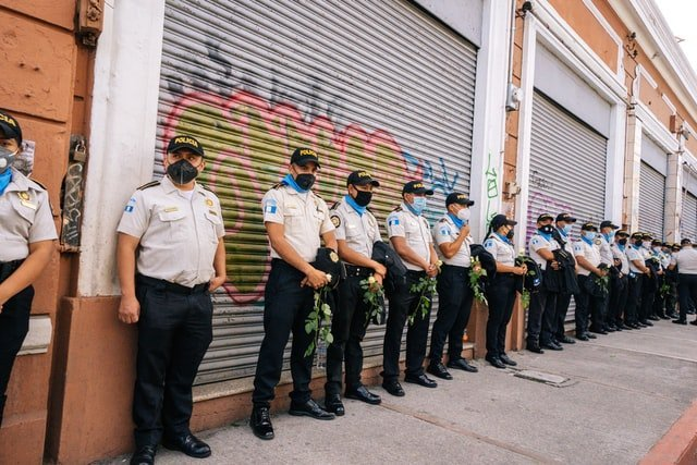 Police line up on street in Guatemala