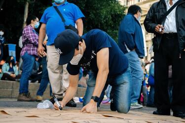 Man writing on sidewalk in Guatemala