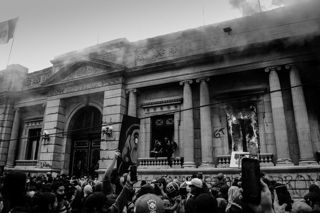 Government Building on fire with protesters Guatemala